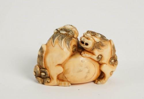 Asian Art & Antiques  - Ivory Netsuke of 2 shishi the Paws on a ball