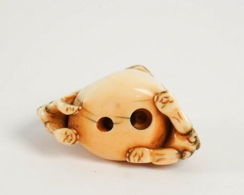 Ivory Netsuke of 2 shishi the Paws on a ball -
