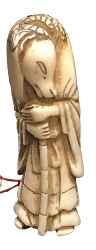 Ivory Netsuke of a fox (kitsune) disguised as a woman