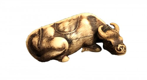 Ivory Netsuke of a lying Buffalo - Yoshinaga