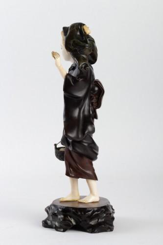 A Bronze and Ivory figure of Shell Gatherer - Hidemitsu -