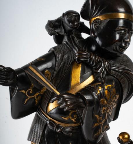 Asian Works of Art  - A Sarumawashi (monkey showman) Japanese Bronze