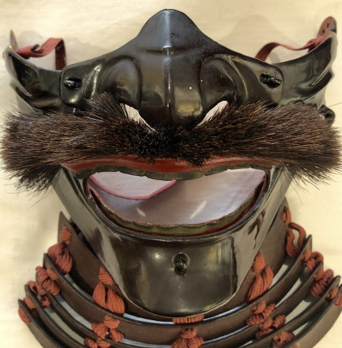 Asian Works of Art  - Menpo (Protective Mask) of Armour in Brown Laquered Iron