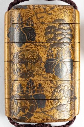 Inro à 4 cases en laque or et argent 18ème siècle -