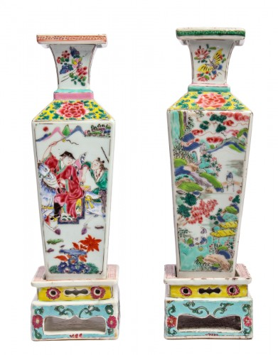 A pair of Famille rose vases on porcelain stands, Yongzheng period