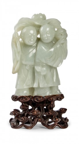 An outstanding pale celadon nephrite jade group of theHe He twins, 19th C.