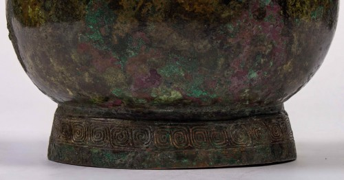 "Asian Works of Art  - A ritual wine vessel ""You"" bronze vase and cover, Warring States period"