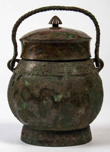 "BC to 10th century - A ritual wine vessel ""You"" bronze vase and cover, Warring States period"