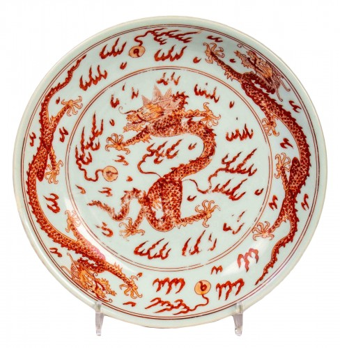 A very rare imperial iron red dragon dish , Kangxi mark and of the period