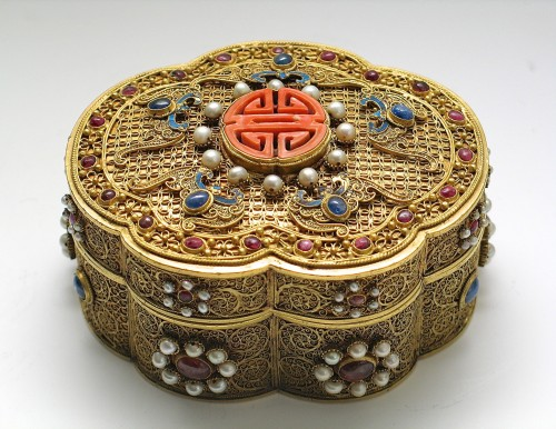 - A Chinese box in filigree gold with coral, kingfisher feathers, hard stones
