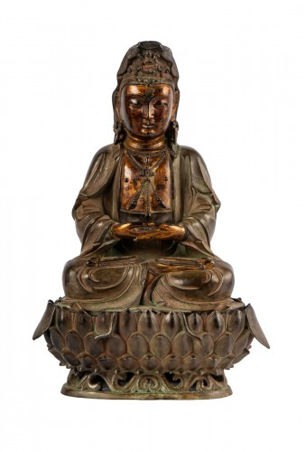 A bronze figure of Guanyin on its lotus stand, late Ming dynasty