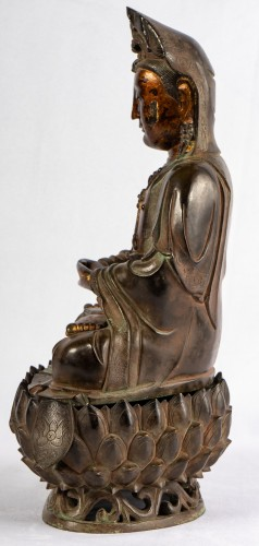 Asian Works of Art  - A bronze figure of Guanyin on its lotus stand, late Ming dynasty