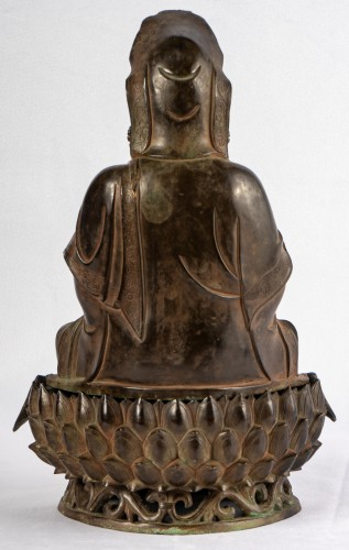A bronze figure of Guanyin on its lotus stand, late Ming dynasty -