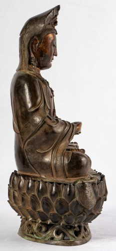 17th century - A bronze figure of Guanyin on its lotus stand, late Ming dynasty