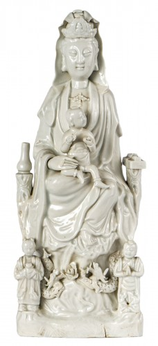 A large Blanc de Chine Dehua figure of Guanyin, Kangxi period