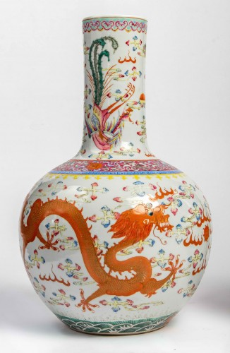 """Asian Works of Art  - A Rare Pair of """"tianqiuping"""" fencaï vases with dragons and phoenixes"""