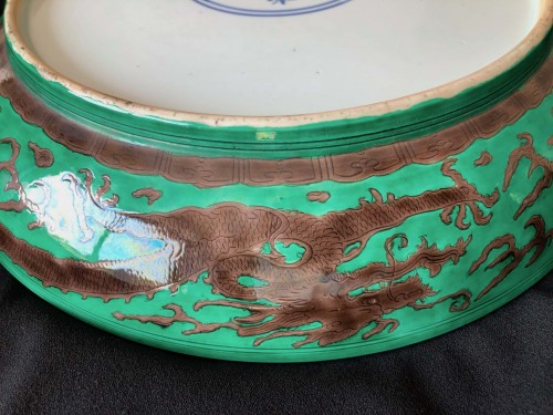 18th century - A large green ground and aubergine dragon dish, Kangxi mark and period