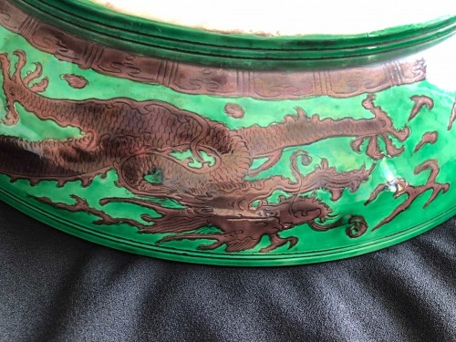 - A large green ground and aubergine dragon dish, Kangxi mark and period