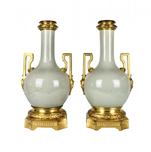 A pair of Guan style crackled glaze lamp bases with ormolu mounts