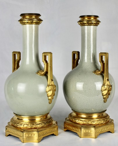 Decorative Objects  - A pair of Guan style crackled lamp bases with ormolu mounts