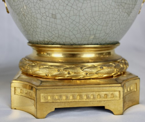 - A pair of Guan style crackled lamp bases with ormolu mounts