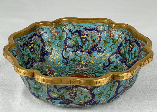 Asian Works of Art  - A lobed cloisonné bowl with lotus and dragons, 19th century