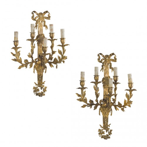 Pair of Napoleon III gilt bronze wall lights
