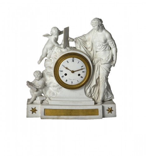An Empire biscuit mantel clock,