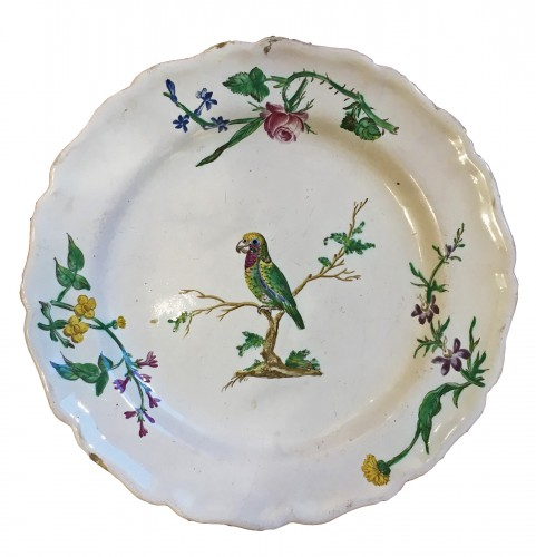 A Marseille plate decorated with a parrot
